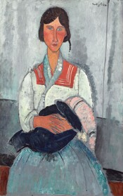 """Shown from the knees up, a woman with peach-colored skin and dark hair sits facing us and holding a baby in this stylized, vertical portrait. The woman's features are elongated and simplified so that the nearly geometric forms are outlined with gray. Loose brushstrokes are visible, throughout, creating a textured, mottled effect. The woman's long, thin face comes to a point at her chin and her brown hair is pulled back on either side of her forehead. She has pale blue eyes, an exaggeratedly long nose, noticeably flushed cheeks, and her coral-pink, bow lips are closed. Her white blouse has a wide, tomato-red, squared collar that lays over her shoulders and a thin, light blue scarf drapes around her neck and down her chest. Her long, full skirt is blended shades of violet and sky blue. The woman's hands, also nearly red, are clasped around a baby wrapped in a navy blue or black blanket. The baby's head is covered with a long pink cap with black and white bands at each end. The woman casts a narrow shadow against the gray wall behind her. Bands of elephant gray, black, and brown behind her across the bottom of the composition suggest an abstracted bench or seat she sits on. The artist signed the work in dark letters near the upper left corner: """"Modigliani."""""""