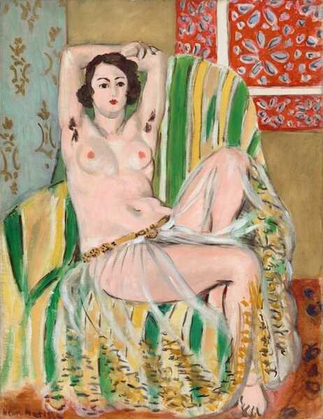 A nearly nude woman with a pale, pink complexion leans back into a striped, upholstered chair with her arms overhead, holding opposite elbows, and one foot tucked under her in this stylized, vertical painting. The scene is painted loosely, making some details indistinct. The woman's torso faces us but her legs are angled slightly to our right, and she looks off in that direction with dark brown eyes under dark, arched brows. Her features are loosely painted but she seems to have a straight nose and her small, scarlet-red mouth is closed. Her dark brown hair curls down to her ears in a chin-length bob. She wears only a gauzy, transparent cloth covering but not obscuring her legs. It is gathered low on her hips with a golden-brown belt, and loosely painted, short and zigzag strokes of chocolate brown and harvest gold suggest embroidery or decoration around the hem. The woman's raised arms show two tufts of dark brown hair in her armpits. She has round breasts with dark pink nipples, and a curving belly and hips. Her left knee, farther from us, is bent sharply against the back of the chair so her foot is tucked behind her other thigh. The chair is striped with lime green, white, and lemon yellow. The floor is terracotta-orange. A strip of light blue with a gold pattern to the left and a red area with a flower pattern to our right suggest fabrics draped on the sand-brown wall.