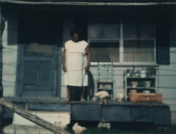 Untitled (Woman on porch)