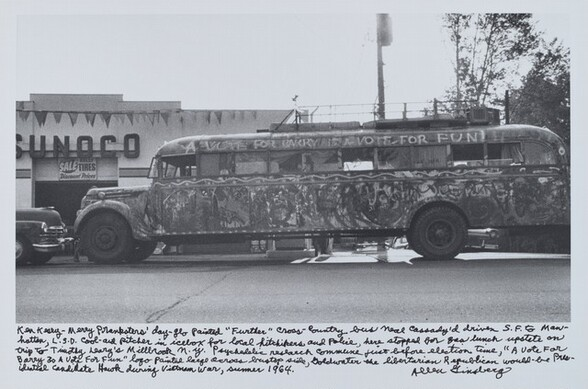 """Ken Kesey—Merry Pranksters' day-glo painted """"Further"""" cross-country bus Neal Cassady'd driven S.F. to Manhattan, L.S.D. cool-aid pitcher in icebox for local hitchhikers and Police, here stopped for gas lunch upstate on trip to Timothy Leary's Millbrook n.y. psychedelic research commune just before election time, """"A Vote For Barry Is A Vote for Fun"""" logo painted large across bustop side, Goldwater the libertarian Republican would-be Presidential candidate Hawk during Vietnam War, summer 1964."""