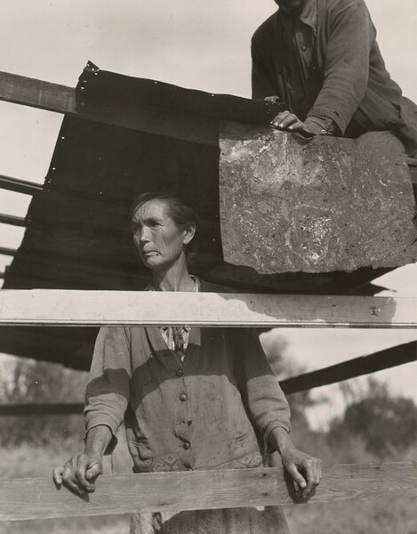 Dispossessed Arkansas farmers. These people are resettling themselves on the dump outside of Bakersfield, California