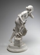"""Carved from white marble, a girl steps and leans forward, away from us in this photograph, on a disk-like pedestal with a wide fluted base. She is dressed in flowing, knee-length dress or toga, which swirls around her, and her feet are bare. She leans forward at the hip, with her bent right leg supporting her weight, while her left leg extends behind her, toe tapping the base with her heel lifted, as if mid-stride. The figure holds her left hand up to her opposite ear in a listening gesture, with her elbow lifted and bent forward. Her right hand clutches a staff, arm bent at the elbow, which she thrusts downward. The end of the staff meets a block of marble at her foot, about the height of the girl's shin, that is a fragment of a column top, carved with decorative leaves and shell-shaped designs. The skirt flickers around the stick as if in a strong wind. The right side of the dress has dropped off her shoulder, baring one breast. The exposed body and limbs are round and smooth. Her hair, carved in undulating waves, is loosely swept back, with a cascade of waves falling over her left shoulder. Her face round and full, and her expression concentrated, with a furrow in her brow and her mouth turned downward, eyes closed. The column fragment at the figure's feet has one smooth face, incised with a rectangle, inside of which is engraved the name """"Randolph Rogers"""" and a date, """"1860."""""""