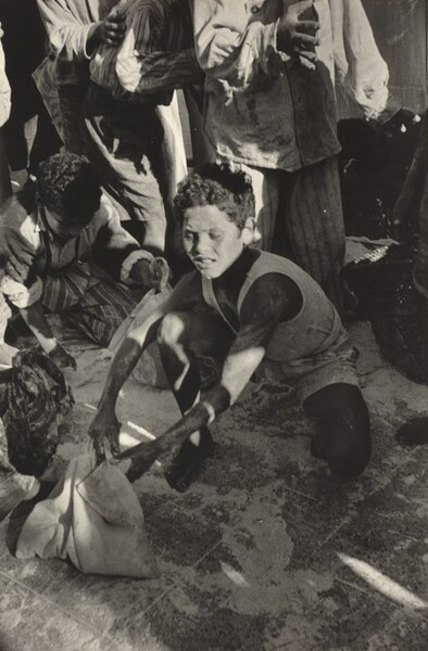 Scraping Up Flour at a Looted Depot, Port Said