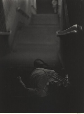 Man lying down, subway steps