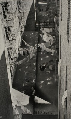 New York:  Courtyard with Laundry and Reflections of Sunlight