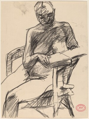 Untitled [nude seated in an armchair reading a book]