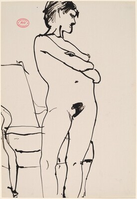 Untitled [female nude standing in front of an armchair]