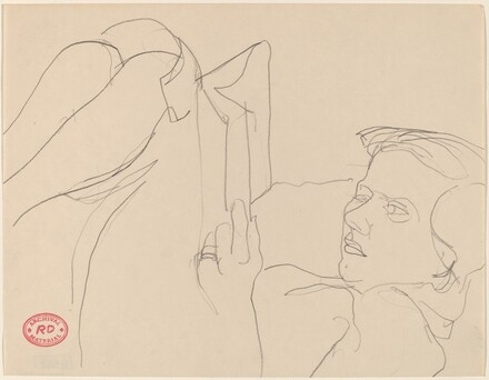 Untitled [woman reclining with knees in air and reading book]