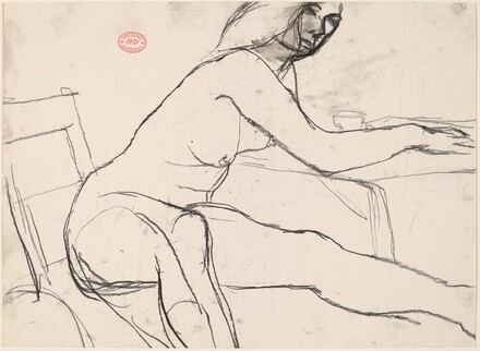 Untitled [seated female nude leaning on table]
