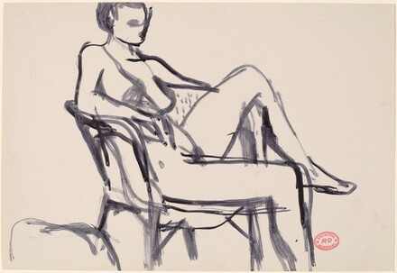 Untitled [seated female nude with left leg over chair arm]