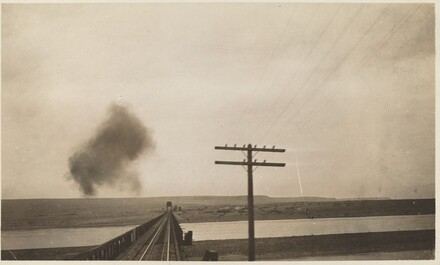 Untitled (Train tracks with puff of smoke)