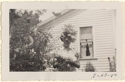 Untitled (Woman with flower in front of head)