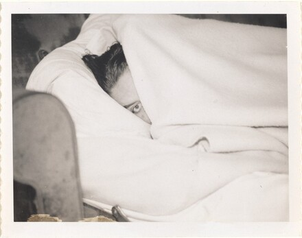 Untitled (Woman's face between blankets)