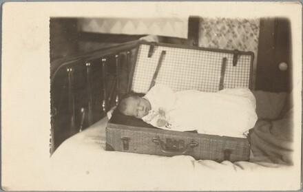 Untitled (Baby in suitcase)