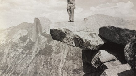 Untitled (Man standing on top of cliff)
