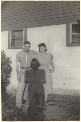 Untitled (Couple posing with woman's shadow between them)