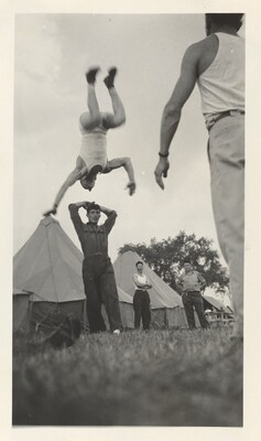 Untitled (Man flipping in air at camp)
