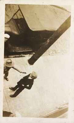 Untitled (Overhead view of men conversing on street)