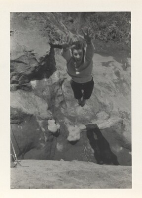 Untitled (Person in air above rocks)