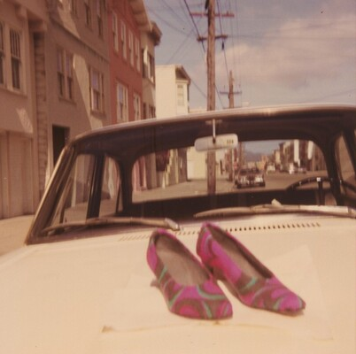 Untitled (Pair of shoes on car)