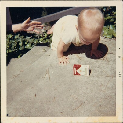 Untitled (Baby with cigarette box)