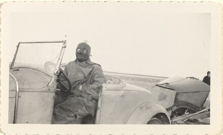 Untitled (Masked man sitting in car)