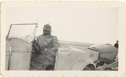 Untitled (Masked man sitting in car)