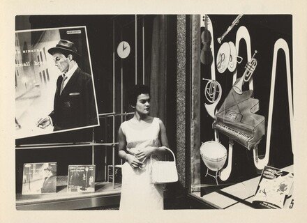 Untitled (Woman standing in front of record store)