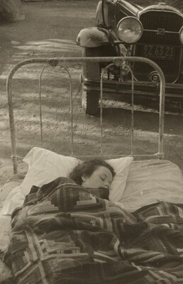 Untitled (Girl sleeping in bed outdoors)