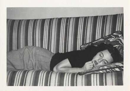 Untitled (Woman asleep on striped sofa)