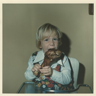 Untitled (Boy with piece of meat)