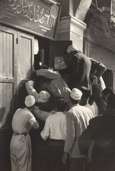 David Seymour (Chim), Breaking into a Food Store, Port Said, 1956