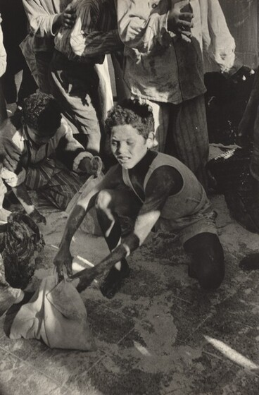 David Seymour (Chim), Scraping Up Flour at a Looted Depot, Port Said, 1956
