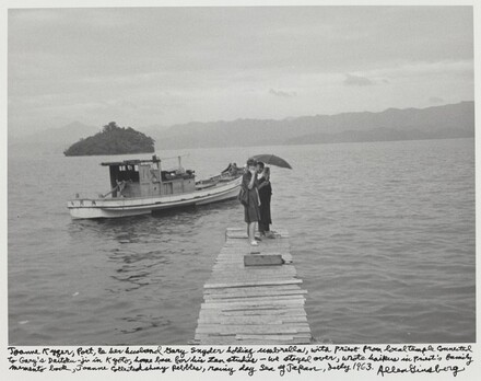 Joanne Kyger, poet, & her husband Gary Snyder holding umbrella, with priest from local temple connected with Gary's Daitoku-ji in Kyoto, home base for his Zen studies - we stayed over, wrote haikus in priest's family memento book, Joanne collected shiny pebbles, rainy day Sea of Japan, early 1963.