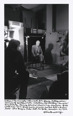 William S. Burroughs interviewed for Heavy Petting film memoir of youthful erotic initiations, his secretary James Grauerholz leaning forward observing discussion of sex world 1930 – 40s, final movie version cut out Bill's queer loves. Obie Benz's Soho loft, New York, December 21, 1986.