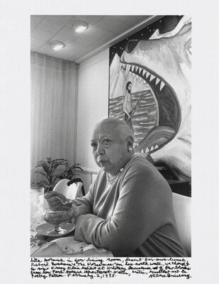 """Lita Hornick in her dining room, dessert for our lunch, Richard Boseman's """"The Norseman"""" on her north wall, we thought to visit Franz Klein exhibit at Whitney Museum a few blocks from her Park Avenue apartment. Writer, critic, excellent art & poetry patron. February 2, 1995."""