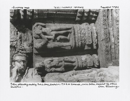 Peter Orlovsky smoking Indian Hemp, November 1962 at Konarak beside fallen segment of stone sculpture —