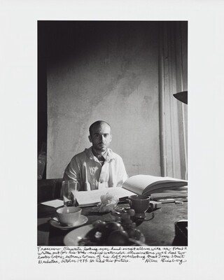 Francesco Clemente looking over hand-script album with new poem I'd written out for his Blake-inspired watercolor illuminations, we'd done two books before; entrance corner of his loft overlooking Great Jones Street Manhattan, October 1984. He liked this picture.