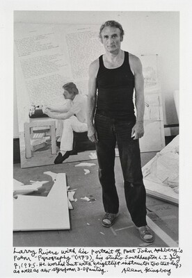 "Larry Rivers with his portrait of poet John Ashbery's poem ""Pyrography"" (1977), his studio Southhampton L. I. July 7, 1985. He worked out with weightlift instructor too that day, as well as new styrofoam 3-D painting."