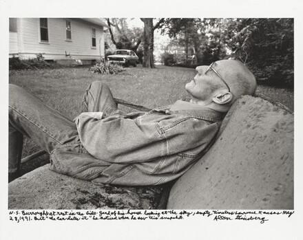 "W. S. Burroughs at rest in the sideyard of his house looking at the sky, empty timeless Lawrence Kansas May 28, 1991. But ""the car dates it"" he noticed when he saw this snapshot."
