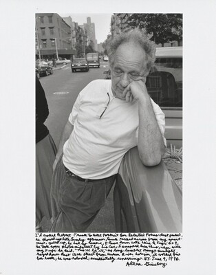 "I'd asked Robert Frank to take portrait for Selected Poems dust jacket, he showed up late Sunday afternoon, truck parked across from my apartment, yelled up, he had no camera. I came down with Leica & Fuji 6×9, he took some photos midstreet by his car, I snapped him thus, then with my Fuji he said, ""This'll be it,"" as long lambent orange sunlight rayed down East 12th Street from Hudson River horizon, it worked fine for book, he was relaxed, accidentally unerring. N.Y. June 9, 1996."