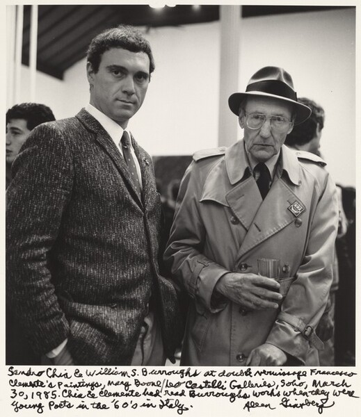 Sandro Chia & William S. Burroughs at double vernissage Francesco Clemente's paintings, Mary Boone/Leo Castelli Galleries, Soho, March 30, 1985. Chia & Clemente had read Burroughs works when they were young poets in the '60's in Italy.