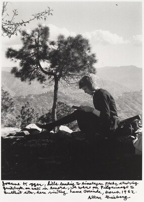 Joanne Kyger, hills leading to Himalayan flats, studying guidebook on wall in Aurora, we were on Pilgrimage to Buddhist sites, here visiting Lama Govinda, March 1962.