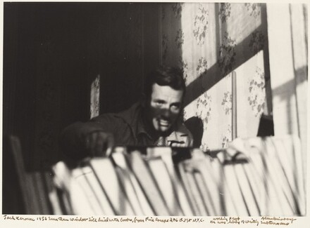 Jack Kerouac 1953 Seen through window sill lined with books, from Fire Escape 206 E. 7 St. N.Y.C. He was living or writing Subterraneans