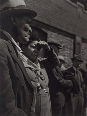 Woman Shading Eyes