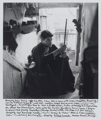 "Gregory Corso Paris 1957 his attic 9 Rue-Gît-Le-Coeur with magic wand, Louvre postcards tacked to wall left, wooden angel kid on wire right, window on courtyard. Burroughs came to live a flight below, Peter Orlovsky & I had window on street two floors down, room with two burner gas stove – LeRoi Jones (Yugen magazine) and Irving Rosenthal (Chicago Review) wrote us from U.S. for poems, Gregory had ""Marriage"" ready, ""Power,"" ""Army"" & ""Police"" also. I began Kaddish, Peter ""Frist Poem,"" Burroughs shaping Naked Lunch. Madame Rachou, Concierge."