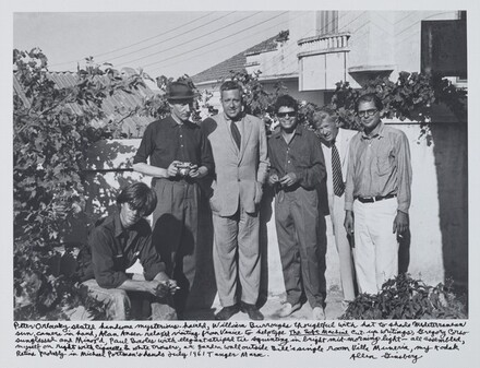 Peter Orlovsky seated handsome mysterious-haired, William Burroughs thoughtful with hat to shade Mediterranean sun, camera in hand, Alan Ansen relaxed visiting from Venice to help type The Soft Machine cut-up writings, Gregory Corso sunglassed and Minox'd, Paul Bowles with elegant striped tie squinting in bright mid-morning light—all assembled, myself on right with cigarette & white trousers, at garden wall outside Bill's single room Villa Muniria, my Kodak  Retina probably in Michael Portman's hands July 1961 Tangier Moroc.