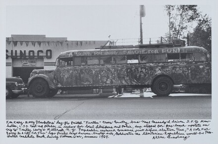 "Allen Ginsberg, Ken Kesey—Merry Pranksters' day-glo painted ""Further"" cross-country bus Neal Cassady'd driven S.F. to Manhattan, L.S.D. cool-aid pitcher in icebox for local hitchhikers and Police, here stopped for gas lunch upstate on trip to Timothy Leary's Millbrook n.y. psychedelic research commune just before election time, ""A Vote For Barry Is A Vote for Fun"" logo painted large across bustop side, Goldwater the libertarian Republican would-be Presidential candidate Hawk during Vietnam War, summer 1964., 19641964"