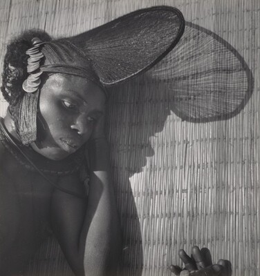 African Woman Wearing Headdress with Coins