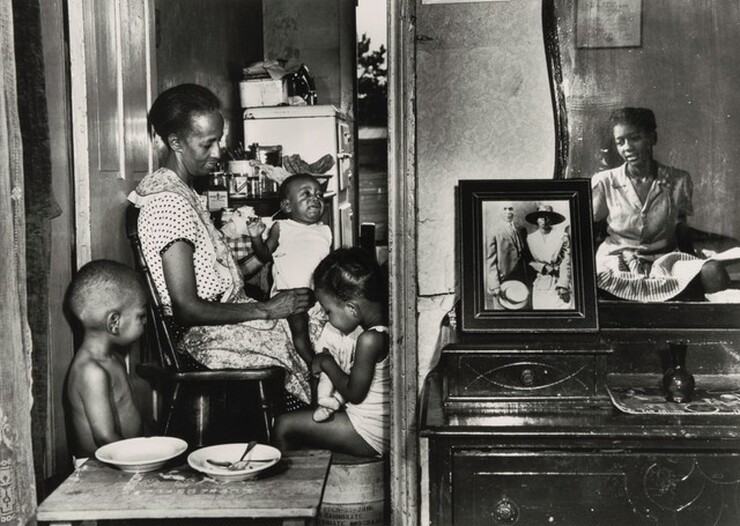 Gordon Parks, Washington, D.C. Mrs. Ella Watson, a government charwoman, with three grandchildren and her adopted daughter, July 1942, printed later